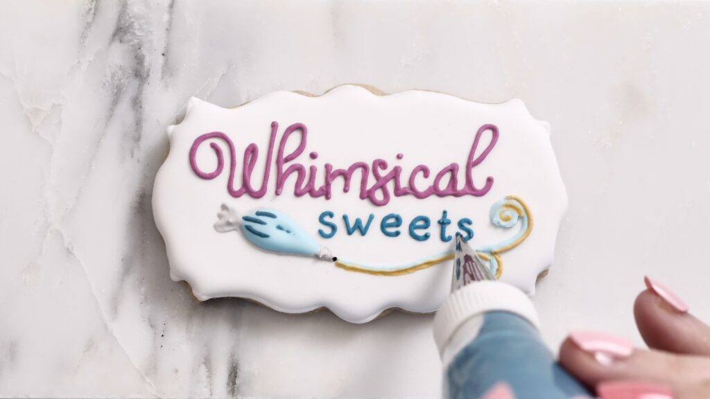 Whimsical Sweets Logo on a cookie