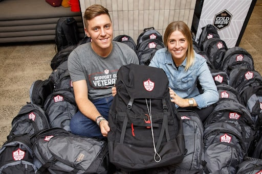 Brett and Alexa surrounded by Backpacks for Life